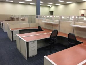 line of empty red cubicles situatied in an office
