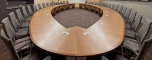 wide angle photo of connected empty meeting desks