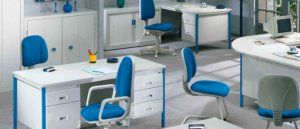 various blue and white office chairs, desks, and cupboards